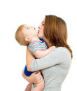 Loving mother holding baby boy isolated on white Royalty Free Stock Image