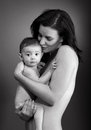 Loving mother holding baby studio shot bw Stock Image