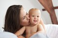 Loving mother kissing child portrait of a Royalty Free Stock Images