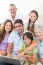 Loving multigeneration family spending leisure time portrait of at home Stock Images