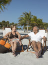 Loving Senior Couple On Beach Vacation Stock Photos