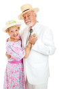 Loving senior couple dancing in southern style clothing together white background Stock Images