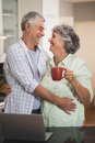 Loving senior couple looking at each other at home Royalty Free Stock Photo