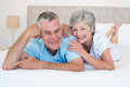Loving senior couple lying in bed portrait of at home Royalty Free Stock Images