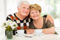 Loving senior couple portrait of relaxing at home Royalty Free Stock Images