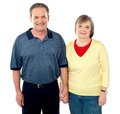 Loving senior couple posing with hand in hand Stock Image
