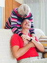 Loving senior couple together happy in home Royalty Free Stock Photography