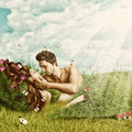 Loving sexy couple lying in bed of grass fantasy romantic collage a outdoor summer Royalty Free Stock Photos