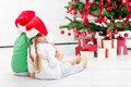 Loving siblings in front of the christmas tree Royalty Free Stock Photo