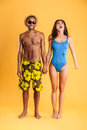 Loving smiling couple in swimwear holding hands Royalty Free Stock Photo