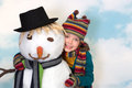 Loving the snowman Stock Photography