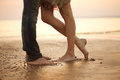 A loving young couple hugging and kissing on the beach. Lovers m Royalty Free Stock Photo