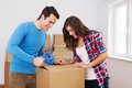 Loving young couple packing boxes Royalty Free Stock Images