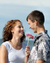 Loving young couple at sea is embracing Royalty Free Stock Photo