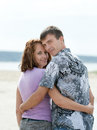 Loving young couple at sea is embracing beach Royalty Free Stock Photo