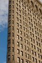 Low Angle Architectural Exterior View of Upper Floors of Historic Flatiron Building in Manhattan, New York City Royalty Free Stock Photo