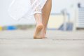 Low angle barefoot woman walking away Royalty Free Stock Photo
