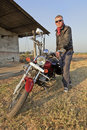 Low angle Caucasian biker tourer India Royalty Free Stock Photography