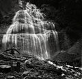 Low angle greyscale shot of the Bridal Veil Falls in the Provincial Park in Bridal, Canada Royalty Free Stock Photo