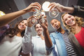 Low angle portrait of happy colleagues toasting with champagne in office creative Stock Images