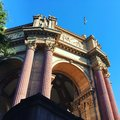 Low angle shot of The Palace of Fine Arts and a bird flying under the breathtaking sky Royalty Free Stock Photo