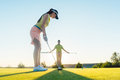 Fit woman exercising hitting technique during golf class with an