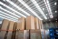Low angle view of cardboard boxes put on pallets Royalty Free Stock Photo