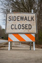 Low Angle View of Dirty Sidewalk Closed Sign Royalty Free Stock Photo