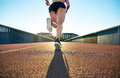 Low angle view of female jogger bounding forward Royalty Free Stock Photo