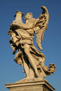 Low angle view of a statue an angel on the top bridge ponte sant angelo rome lazio italy Stock Images