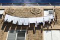 Low angle view of white laundry drying on the clothline under high noon sun shot at the old town of acco israel Stock Photography