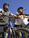 Low angle view of a young couple mountain biking Royalty Free Stock Photo