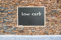 Low carb on chalkboard and stone wall background Stock Image