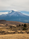 Low clouds at peak of mt shasta cover the top located in the high desert northern california Royalty Free Stock Images