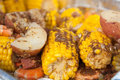 Low country boil a traditional with red potatoes corn on the cob and shrimp everything is seasoned to perfection with cajun spices Royalty Free Stock Photography