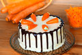 Low fat carrot cake decorated with whole and chopped Stock Photo