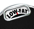 Low fat words scale nutritional food choice snacks on a to illustrate the importance of healthy and choices in losing weight and Royalty Free Stock Images
