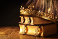 low key of beautiful queen/king crown on old books. vintage filtered. fantasy medieval period Royalty Free Stock Photo