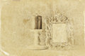 Low key image of vintage antique classical frame and Burning candle on wooden table. retro filtered image. Old style photo. Royalty Free Stock Photo