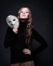 Low key portrait of a beautiful woman holding mask Royalty Free Stock Photo