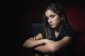 Low key portrait of a sad teenage girl Royalty Free Stock Photo