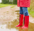 Low section of a female in a muddy puddle Royalty Free Stock Photos