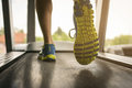 Low section of man exercising on treadmill. Royalty Free Stock Photo