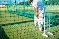 Low section of man playing cricket at field Royalty Free Stock Photo