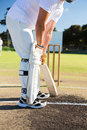 Low section of man playing cricket at sports field Royalty Free Stock Photo