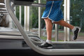Low section of man on treadmill a running a Stock Images