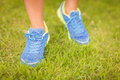 Low section of person walking on grass Royalty Free Stock Photo