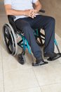 Low section of a senior man sitting in wheelchair at hospital corridor Royalty Free Stock Photo