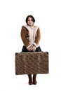 Low smiling girl with a large suitcase on white background Royalty Free Stock Image