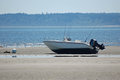 Low tide boat a fishing resting on the sand during Royalty Free Stock Images